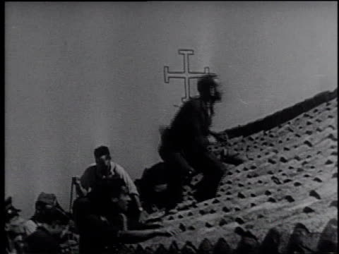 soldiers firing artillery / civilians and soldiers running / soldier flipping a stick grenade off the roof a building / grenade exploding / bombers... - frank capra video stock e b–roll