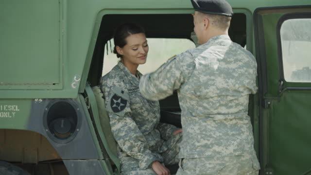 soldiers flirting in military vehicle / lehi, utah, united states - lehi stock videos & royalty-free footage