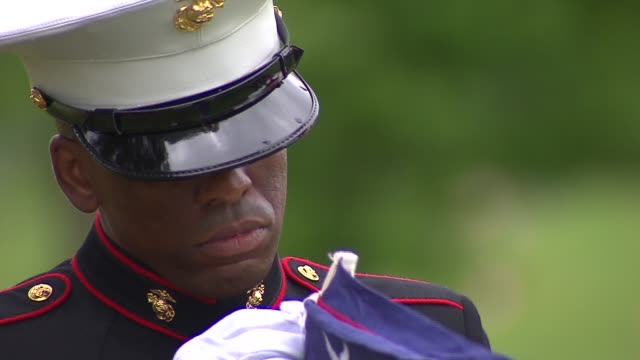 soldiers fold american flag at a memorial day ceremony. pfc james michels, a u.s. marine from chicago, was honored at queen of heaven catholic... - folded stock videos & royalty-free footage