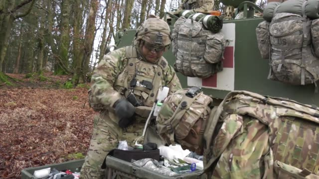 soldiers from 1st battalion 18th infantry regiment set up a medical aid station during allied spirit viii in hohenfels germany on jan 26 2018 - battalion stock videos & royalty-free footage