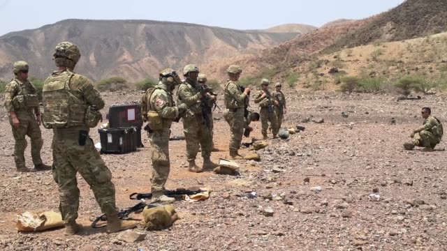 soldiers from attack company assigned to combined joint task forcehorn of africa's east african response force carry out a live fire exercise with m4... - horn of africa stock videos & royalty-free footage