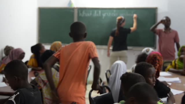 us soldiers from charlie company 443 civil affairs battalion teach english to djiboutian students during an english discussion group march 2018 in... - アルファベット点の映像素材/bロール