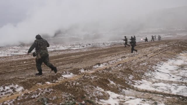 soldiers from company b, 1st battalion, 18th infantry regiment, work with the bulgarian 42nd mechanized infantry battalion, yambol, bulgaria, while... - 連隊点の映像素材/bロール