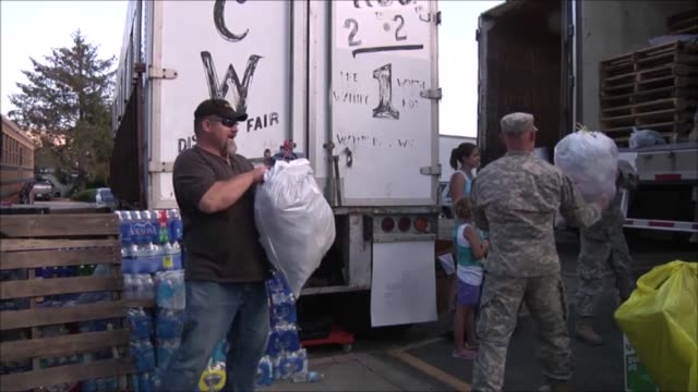 soldiers from hhc 161st infantry washington national guard assist the community of pateros wash at their donation site at the local high school... - national guard stock videos and b-roll footage