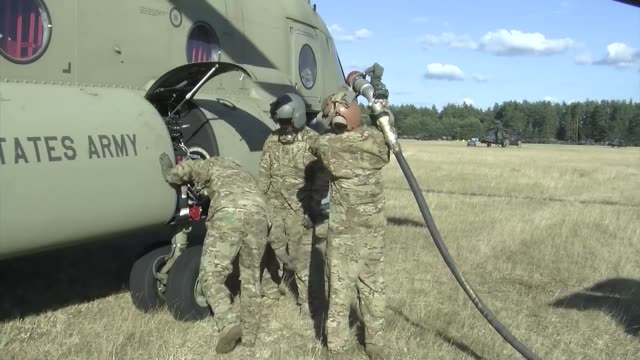 soldiers from task force viper 1st battalion 3rd aviation regiment 12th combat aviation brigade refuel a ch47 chinook helicopter during saber strike... - regiment stock videos & royalty-free footage