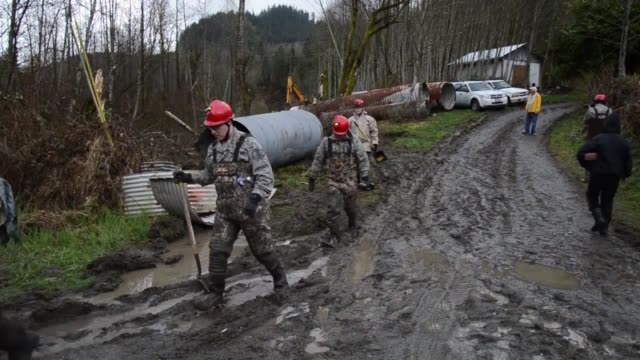 soldiers from the 141st civil engineering squadron washington national guard assist local civilian authorities in the search and rescue operations in... - oso washington stock videos & royalty-free footage