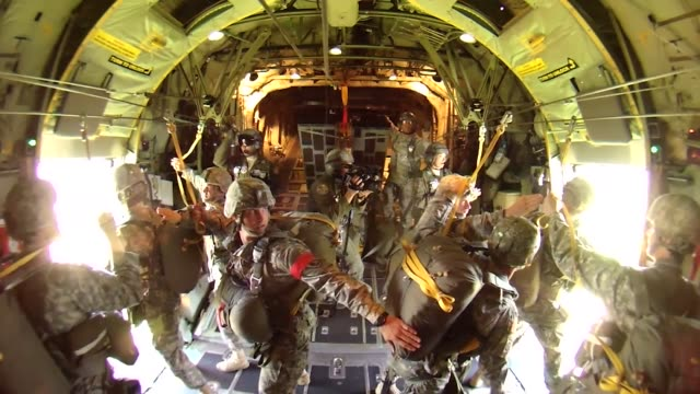 soldiers from the 173rd airborne brigade preparing fellow service members from the us and allied nations to perform static line jumps from a nevada... - french army stock videos & royalty-free footage