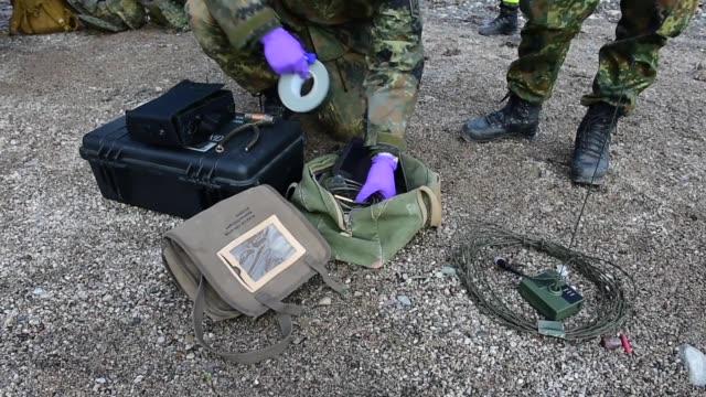 soldiers from the 2nd multinational engineer battalion german explosive ordnance disposal team conduct a scenario based training exercise at camp... - bagnato bildbanksvideor och videomaterial från bakom kulisserna