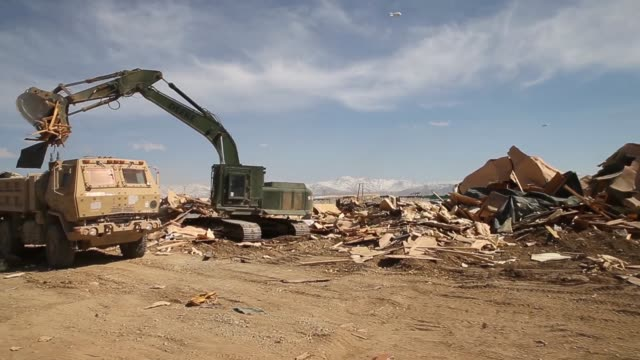 pan soldiers from the 858 engineer company 223 engineer battalion of the mississippi national guard demolish and haul away structures on forward... - 懐中時計点の映像素材/bロール