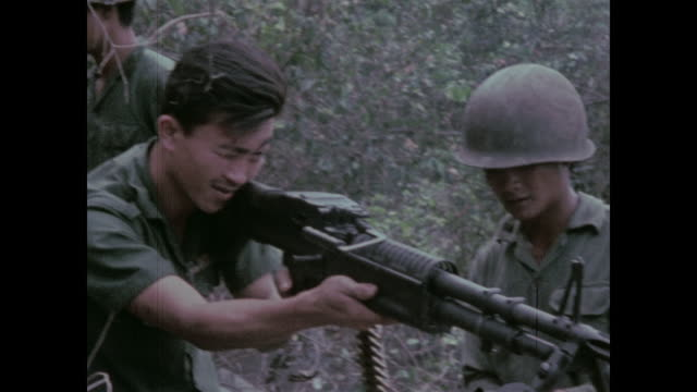 soldiers from the 9th arvn division prepare to attack a cave complex being used by enemy soldiers preparing machine gun - south vietnam stock videos & royalty-free footage