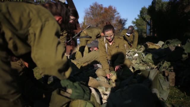 soldiers from the artillery corps carry their comrade on a stretcher while taking part in a baret march at the end of their basic army training on... - israeli military stock videos & royalty-free footage