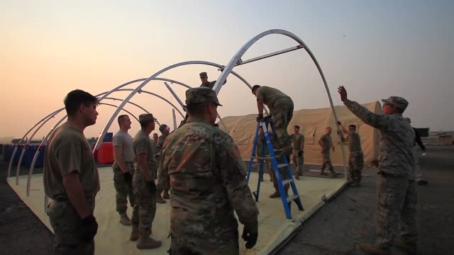 soldiers from the california army national guard build alaska tents near the california governor's office of emergency services base camp in chico... - base camp stock videos and b-roll footage