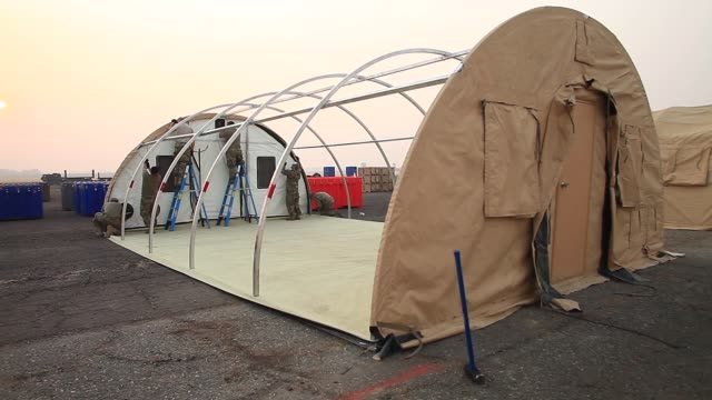 soldiers from the california army national guard build alaska tents near the california governor's office of emergency services base camp in chico... - base camp stock videos & royalty-free footage