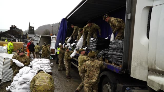 soldiers from the highlanders, 4th battalion, the royal regiment of scotland, help to shore up flood defences as storm dennis begins to make landfall... - infantry stock videos & royalty-free footage