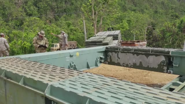 Soldiers from the Puerto Rico National Guard 892nd MultiRole Bridge Company construct a temporary bridge at Guajataca Dam