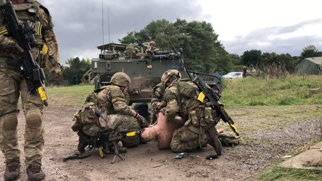soldiers from the royal anglian regiment treat an artificial casualty during a mission rehearsal exercise ahead of the uk task group deployment to... - atlantic islands stock videos & royalty-free footage