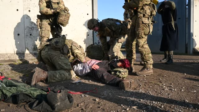 soldiers from the royal anglian regiment work to provide medical assistance to an amputee role-play actor during a mission rehearsal exercise ahead... - military stock videos & royalty-free footage