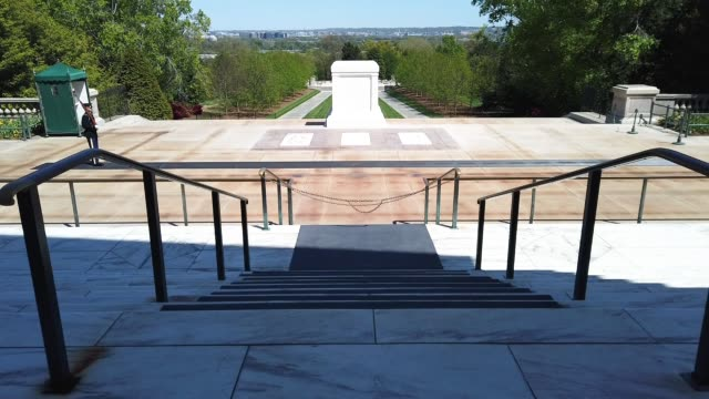 """soldiers from the u.s. army 3rd infantry regiment, also called """"the old guard,"""" maintain social distancing to prevent the spread of the novel... - arlington virginia video stock e b–roll"""