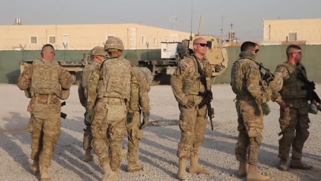 ts soldiers from the us army's 4th squadron 2d cavalry regiment get briefed before heading out on a mission on february 26 2014 near kandahar... - 2001年~ アフガニスタン紛争点の映像素材/bロール