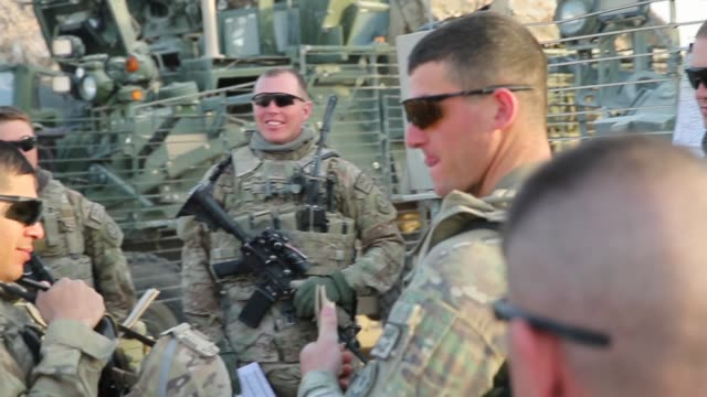 TS Soldiers from the US Army's 4th squadron 2d Cavalry Regiment get briefed before heading out on a mission on February 26 2014 near Kandahar...