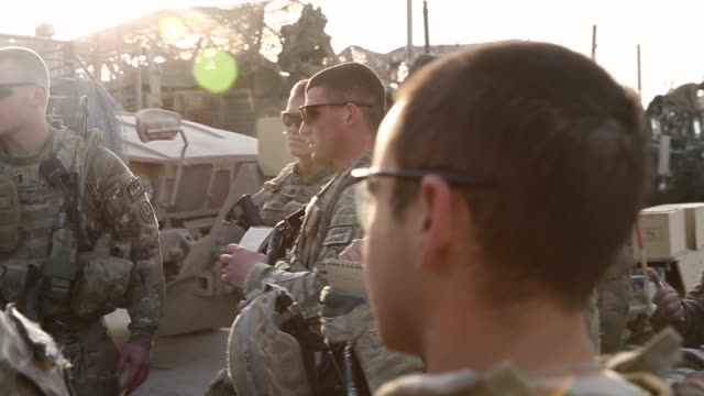 stockvideo's en b-roll-footage met ts soldiers from the us army's 4th squadron 2d cavalry regiment get briefed before heading out on a mission on february 26 2014 near kandahar... - kandahar afghanistan