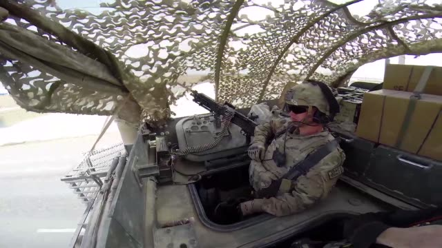 stockvideo's en b-roll-footage met ms soldiers from the us army's 4th squadron 2d cavalry regiment head out for patrol in a stryker vehicle on march 2 2014 near kandahar afghanistan - kandahar afghanistan