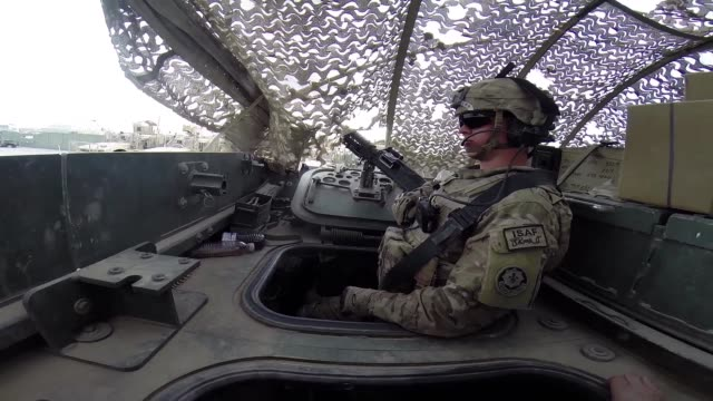 vídeos de stock e filmes b-roll de soldiers from the us army's 4th squadron 2d cavalry regiment head out for patrol in a stryker vehicle on march 2 2014 near kandahar afghanistan - kandahar