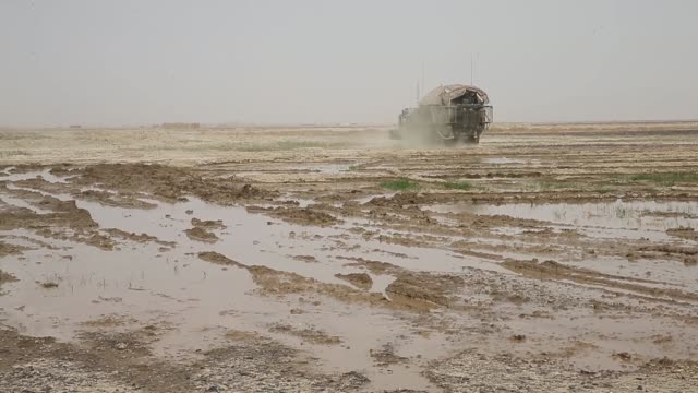 ds soldiers from the us army's 4th squadron 2d cavalry regiment move through a muddy field with a stryker vehicle while on patrol with soldiers from... - afghan national army stock videos & royalty-free footage