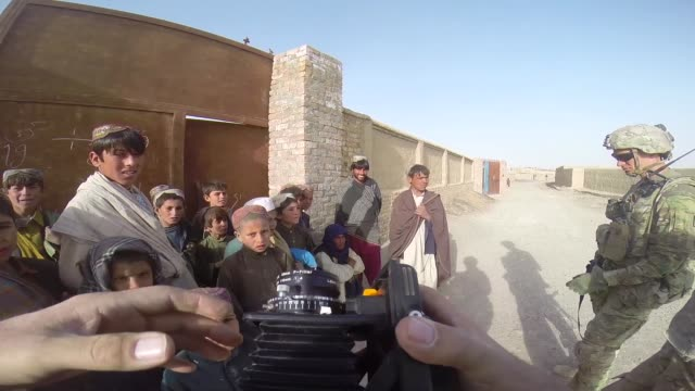 soldiers from the us army's 4th squadron 2d cavalry regiment patrol through a village on march 3 2014 near kandahar afghanistan - kandahar afghanistan stock videos & royalty-free footage