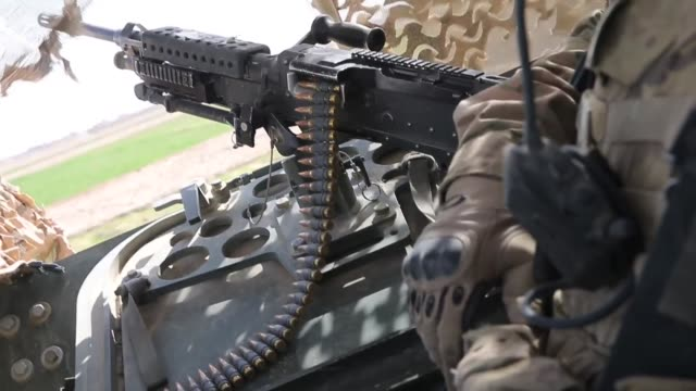 stockvideo's en b-roll-footage met cu soldiers from the us army's 4th squadron 2d cavalry regiment patrol along a highway on march 4 2014 near kandahar afghanistan - kandahar afghanistan