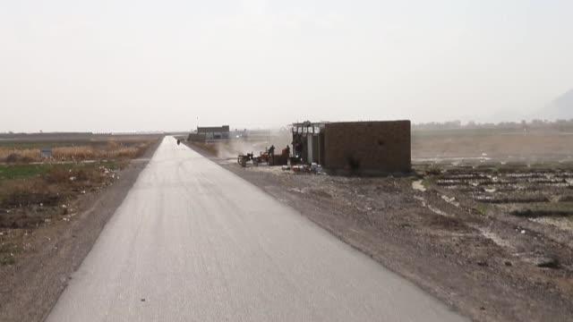 ls soldiers from the us army's 4th squadron 2d cavalry regiment patrol on february 26 2014 near kandahar afghanistan - 2001年~ アフガニスタン紛争点の映像素材/bロール
