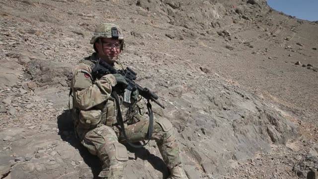 pan soldiers from the us army's 4th squadron 2d cavalry regiment patrol on february 28 2014 near kandahar afghanistan - 2001年~ アフガニスタン紛争点の映像素材/bロール