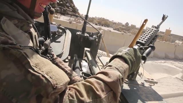cu soldiers from the us army's 4th squadron 2d cavalry regiment patrol on february 28 2014 near kandahar afghanistan - 2001年~ アフガニスタン紛争点の映像素材/bロール