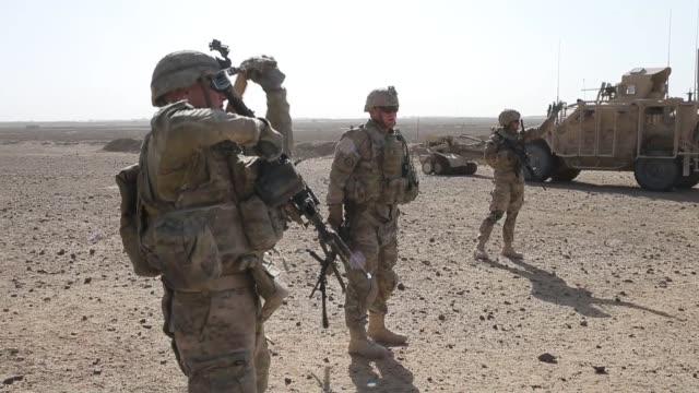 ls soldiers from the us army's 4th squadron 2d cavalry regiment patrol on february 28 2014 near kandahar afghanistan - 2001年~ アフガニスタン紛争点の映像素材/bロール