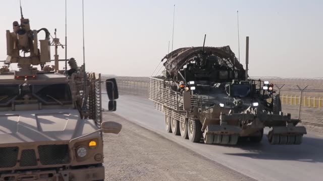 ms soldiers from the us army's 4th squadron 2d cavalry regiment patrol on february 28 2014 near kandahar afghanistan - 2001年~ アフガニスタン紛争点の映像素材/bロール
