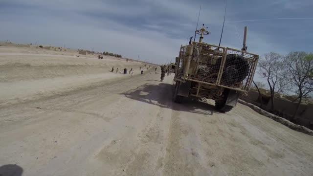 soldiers from the us army's 4th squadron 2d cavalry regiment patrol on march 5 2014 near kandahar afghanistan - 2001年~ アフガニスタン紛争点の映像素材/bロール