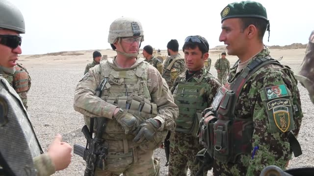 ms soldiers from the us army's 4th squadron 2d cavalry regiment patrol with soldiers from the afghan national army on march 4 2014 near kandahar... - afghan national army stock videos & royalty-free footage