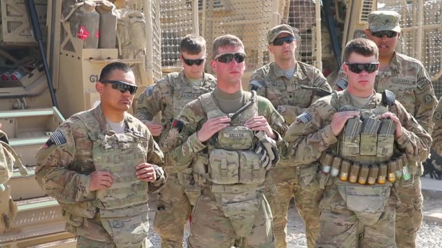ms soldiers from the us army's 4th squadron 2d cavalry regiment prepare to go out on patrol on march 5 2014 near kandahar afghanistan - conflittualità video stock e b–roll