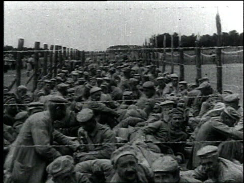 soldiers gather together to wait and eat food / france - resting stock videos & royalty-free footage
