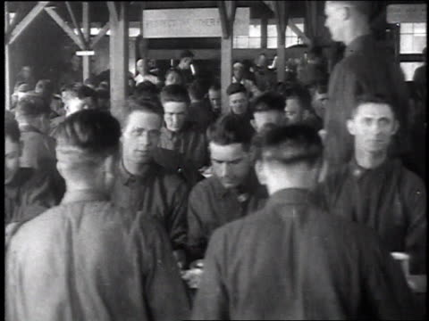 stockvideo's en b-roll-footage met montage soldiers gathering around tables and sitting down for a meal / chillicothe ohio united states - chillicothe
