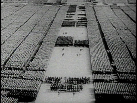 soldiers gathering beneath swastika flags at a 1930s nazi rally / nuremberg, germany - nazi swastika stock videos & royalty-free footage