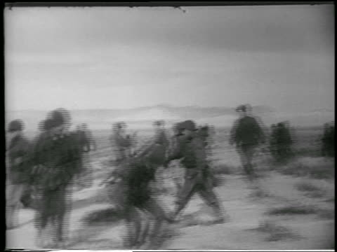 PAN soldiers get into foxholes in desert before atomic bomb explosion / Yucca Flats Nevada