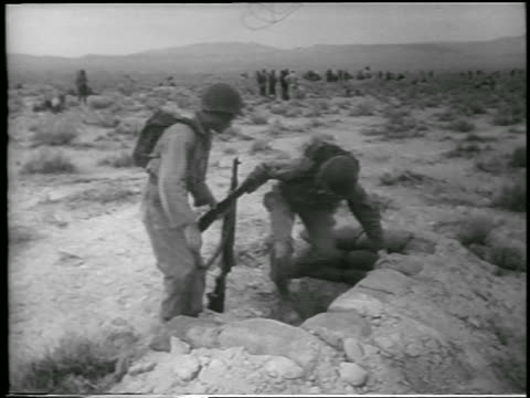 soldiers get into foxholes in desert before h-bomb explosion / yucca flats, nevada / news. - 1952 stock videos & royalty-free footage