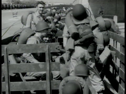 soldiers getting into open transport trucks. us transport trucks w/ soldiers moving in line on city street. jeeps moving down center aisle of parked... - kolkata stock videos & royalty-free footage