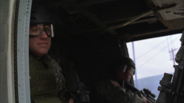 CU, SHAKY, SLO MO, Soldiers getting off military helicopter, USA