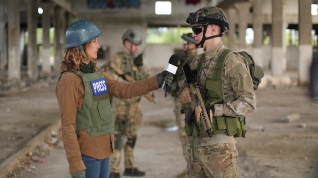 soldiers giving interview to press - microphone stock videos & royalty-free footage