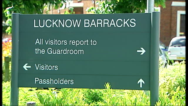 soldiers go on trial for 'beasting' death r04070615 ext name 'lucknow barracks' on direction sign soldier on patrol inside barracks - barracks stock videos and b-roll footage