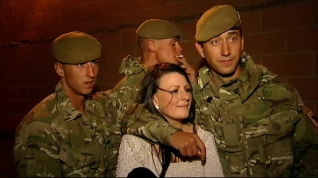 soldiers greeting friends and family at homecoming vox pops soldiers one with arm around girlfriend and father holding children - vox populi stock videos and b-roll footage
