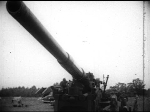 Soldiers hand cranking M65 Atomic Cannon barrel upward barrel rising BEHIND Automatic loading of weapon soldier pulling firing cord WS Artillery gun...
