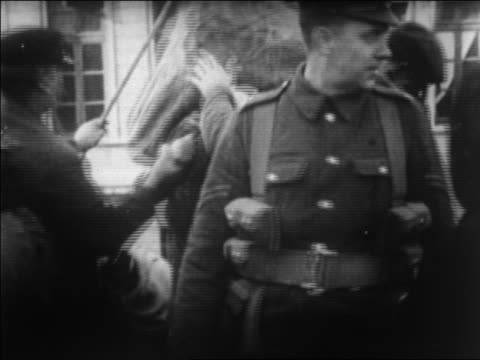 b/w 1920 soldiers helping greek refugees onto ship fleeing from turkey / newsreel - anno 1920 video stock e b–roll